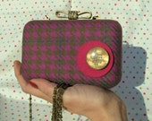 Pink clamshell clutch