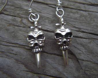 Skull with a dagger earrings in sterling silver