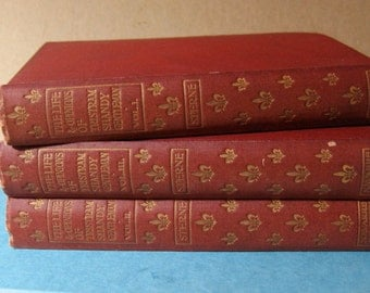 set of three antique red hardback volumes of Tristram Shandy