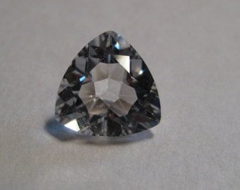 White  Topaz  faceted gemstone ....     9 mm trillion x 4.6 ...............           a937