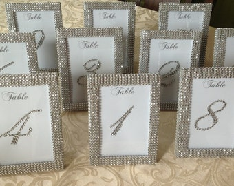 set of 8 5 x 7 silver rhinestone frames and 8 rhinestone covered table numbers wedding or special event