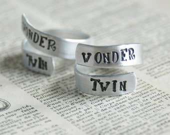 A Pair of Wonder Twins Rings - Adjustable Hand Stamped Aluminum Twist Ring  By Inspired Jewelry Designs