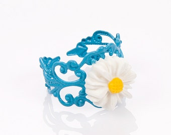 White daisy,resin flower,blue adjustible fligree ring.