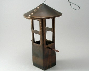 Bird Feeder with Two Openings that Hangs from a Stainless Stell Cable and Finished in a Metallic Bronze Glaze