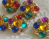 9 Pieces  Vintage Antique Gold Tone Plastic  Jeweled  Shank Buttons with Teal, Yellow, Red, Purple and Blue Rhinestones.