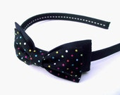 Polka dot bow Alice band. Black and multi coloured hairband