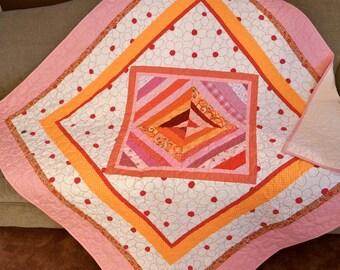 Pink and Orange Patchwork Quilt