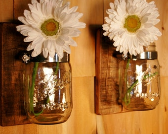 Rustic stained wood pair with clear mason jars mounted on knotty pine wood