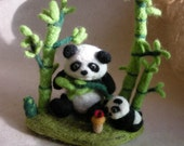 Panda and baby panda in bamboo forest...