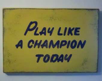 """Play Like a Champion Today Sign     18""""x26"""" - Distressed finish   *Officially Licensed Product*"""