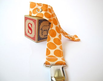 Orange and Cream Pacifier Clip - Amy Butler - Full Moon Polka Dots in Tangerine