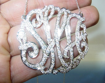 "monogram  sterling silver , 2"" size ,  with 130cz pave' set."