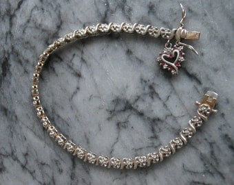 Tennis Bracelet Sterling Silver with 7 Ruby Heart Charm