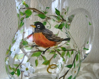 Large hand painted glass pitcher with robins and dogwood blossoms.