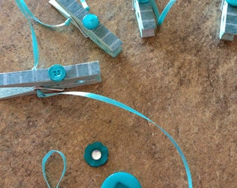 Turquoise Clothespin hanging organizer line. Photo Displays. Post a Note. Hanging Display. Button Embellished. Washi Tape. Satin Ribbon.