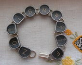 BMW typewriter key bracelet vintage
