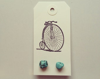 Turquoise earrings on vintage bicycle tag