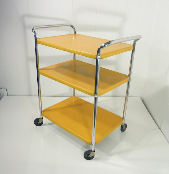 golden yellow metal kitchen cart movable painted vintage 50s