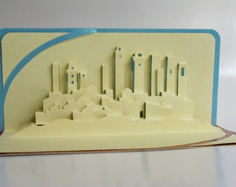 San Gimignano in Italy Pop Up 3D CARD Home Décor Origamic Architecture Hand Cut in Beige on Shimmery Copper and Shimmery Blue. Folds Flat.