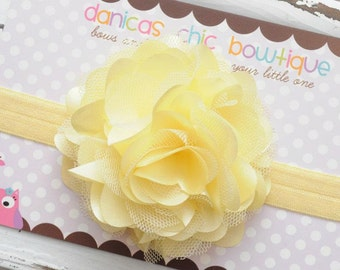 Large light yellow satin mesh flower on yellow headband. Infant, toddler, child, adult sizes