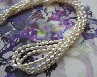 6x4mm Czech Glass White Oval Faceted Pearls 25Pcs.