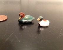2 tiny Little ceramic and plastic  Duck figurines bug house