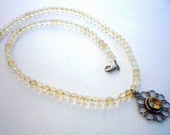 Citrine semiprecious gemstones necklace with Sterling Silver flower Citrine pendant.