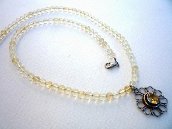 Citrine semiprecious gemstones necklace with Sterling Silver flower Citrine pendant.