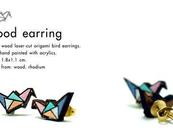 Wood laser-cut origami bird earrings.