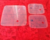 Replacement grids for a Bernina Deco 334 and 340 or Janome MC300e and MC350e embroidery hoops