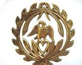 Vintage brass trivet eagle and laurel leaves
