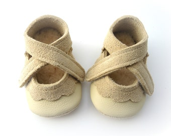 Handmade leather shoes for babies, toddlers and children. Cream beige leather soft soled baby shoes.