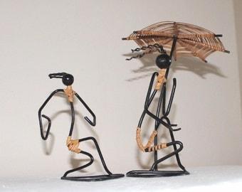 Vintage black wire and raffia figures
