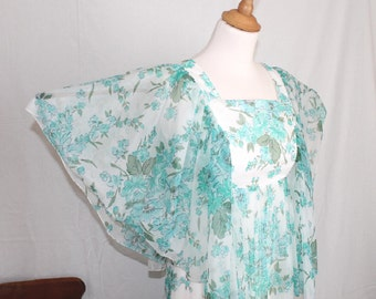 70s floaty chiffon maxi dress pale aqua floral. Cape sleeves full 3 tier skirt. size small