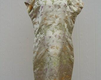 Gold Asian inspired dress.
