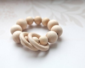 Teething ring toy with wooden beads and 2 wooden rings. Neutral waldorf wooden beads rattle.