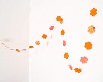 Orange garland in cardboard flowers