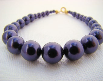 Bracelet, Graduated in Purple Glass Pearls