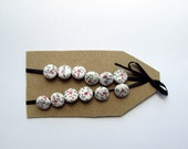tiny (1/2 in) covered buttons with pink and blue flowers on cream ground