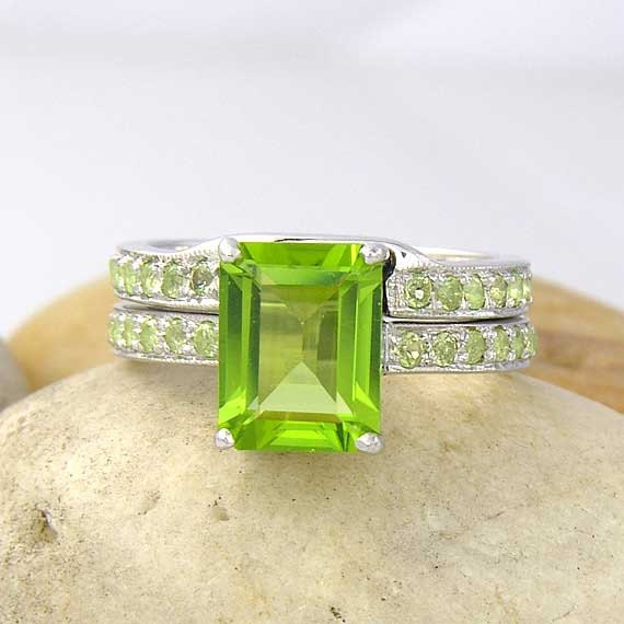 Unavailable listing on etsy for Peridot wedding ring set