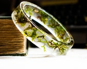 resin bangle bracelet full of floating real botanical emerald green moss. studiobotanica. fashion.