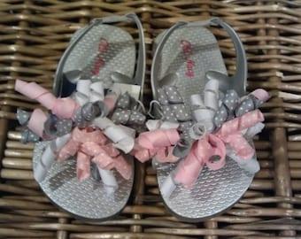 Silver Metallic Korker Bow Toddler Flip Flop Sizes: 5 (3 left), 6 (3 left), 7 (2 left), 8 (6 left), 9 (9 left), 10 (10 left), 12/13 (2 left)