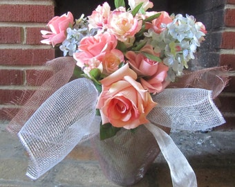 Pastel n Pretty Vase: Various Pink Roses with Blue Babys Breath in a Vase Wrapped in Silver and Brown Décor Mesh Tied with Silver Ribbon