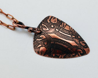 Etched Symmetrical Swirl copper triangle pendant, oxidised and domed