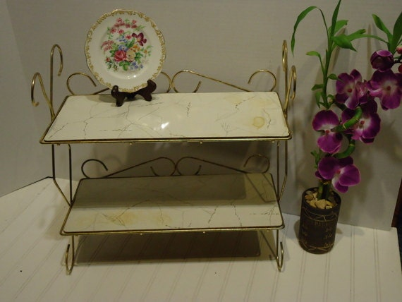 Wonderful metal shelving unit gold tone scrolled by for Bathroom knick knacks
