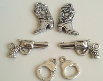 75 Pcs Pistols Boots Hand Cuffs 25 pcs of each