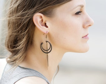 Stacked black ring earrings with chain and vintage steel point drops