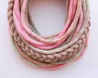 Knitted tube scarf in pastel tones