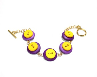 Button bracelet in purple and yellow, with gold toned wire and findings, button jewelry