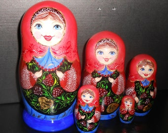 Nesting dolls  Russian matryoshka with the Beads handmade. Painting from Russia in russian folk style Khokhloma.